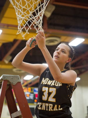Monroe Central's Abigail McGrath cuts down a portion of the game net following their win on Feb. 4 after the Class 2A basketball sectional championship against Lapel. Monroe Central beat Lapel 57-37.