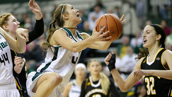UW-Green Bay guard Kaili Lukan (4) drives to the basket during Sunday's Horizon League championship game against UW-Milwaukee at the Kress Events Center in Green Bay.