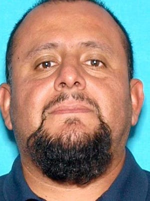 Camarillo police continued to look on Tuesday for Jose Guzman, suspected of killing his wife last week.
