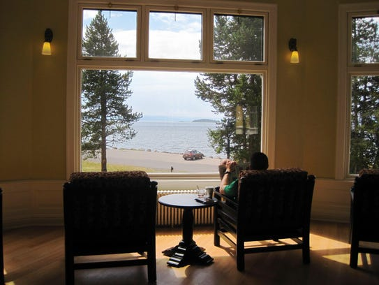 A visitor reads inside Lake Hotel in Yellowstone National