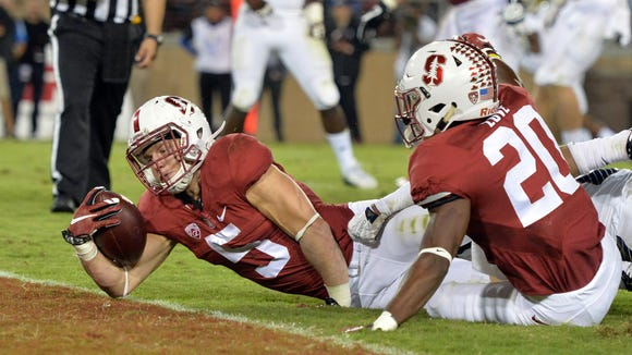 Oct 15, 2015; Stanford, CA, USA; Stanford Cardinal running back Christian McCaffrey (5) scores on a 9-yard touchdown run in the second quarter against the UCLA Bruins in a NCAA football game at Stanford Stadium. Mandatory Credit: Kirby Lee-USA TODAY Sports