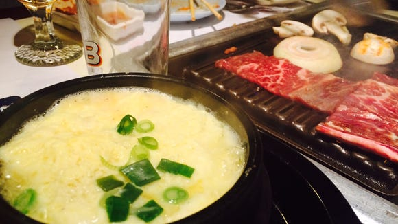 Steamed egg and a grill filled with meats and veggies