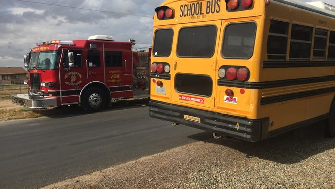 Two children were hospitalized after a car rear-ended a school bus near Buckeye on April 24, 2015.