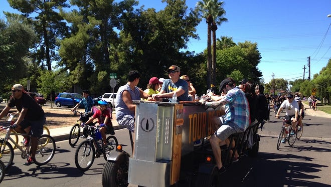 Scottsdale voted Tuesday to allow passengers on certain pedal buses -- those bearing a limousine classifications -- to consume beer and wine in paper and plastic cups.
