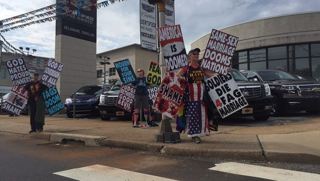 Protesters from Westboro Baptist Church outside the perimeter at Beau Biden's funeral.