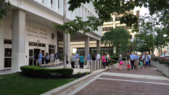 A line forms outside the courthouse in Wilmington Monday morning. Jury selection is set to begin Monday in U.S. District Court .