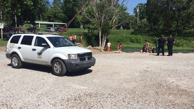 Cotter police on the scene of a swimming accident Thursday afternoon at Cotter Spring.