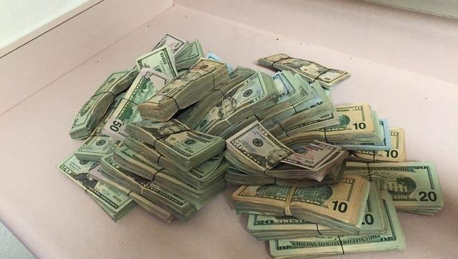 About $95,000 was seized from Thomas' apartment.