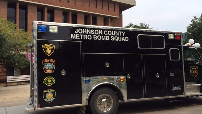 The Johnson County Metro Bomb Squad responds to a suspicious package Monday outside the UI Main Library.