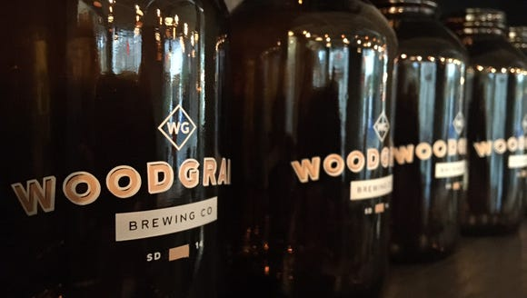 Growlers, little ones, at Woodgrain Brewing Co.