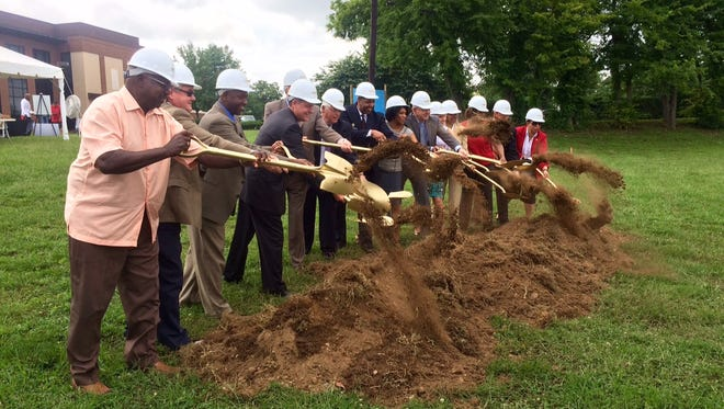 "Officials and community members ""break ground"" for the Franklin Housing Authority's new Reddick Street Apartments."