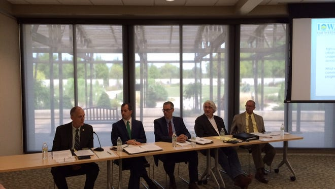 A panel of five debated how to improve Iowa's water quality at the Greater Des Moines Botanical Garden Wednesday.