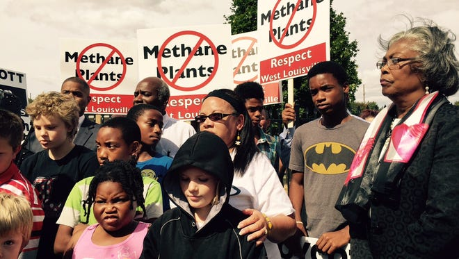 Metro Councilwoman Mary Woolridge joined more than two dozen people at a fall rally against a proposed methane plant in western Louisville.