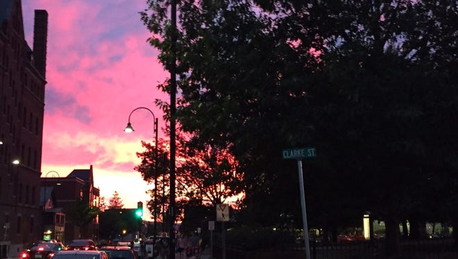 The sun sets to the west of Pearl Street in Burlington early Monday evening.
