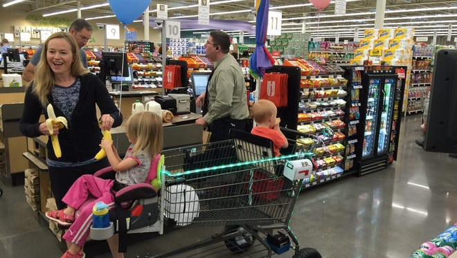 Molly Sanborn visited the new Hy-Vee store in New Hope, Minn., on opening day Tuesday. Sanborn customized a shopping cart to take to the store with her two children.