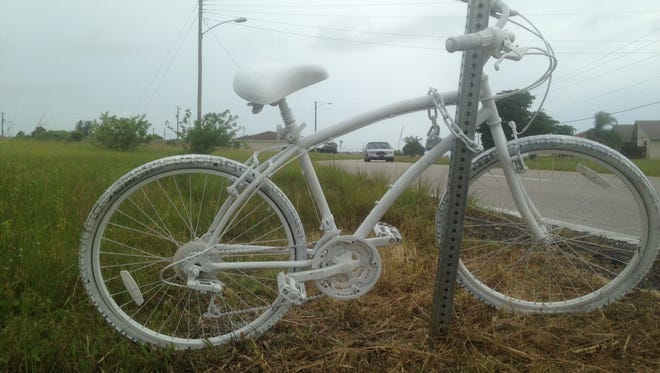 A ghost bike memorial to Scott Johnson of Cape Coral, killed Sept. 28, 2014, by a speeder along Diplomat Parkway, was replaced Sunday after the first version was damaged by vandals and a vehicle.