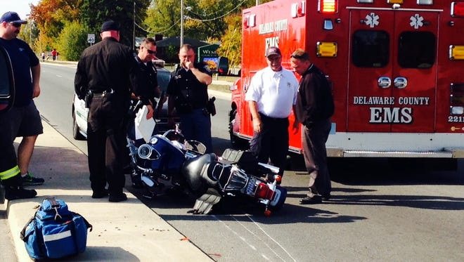 Police and EMS respond to a motorcycle crash near the intersection of Nebo and Kilgore on Wednesday, Oct. 21, 2015.