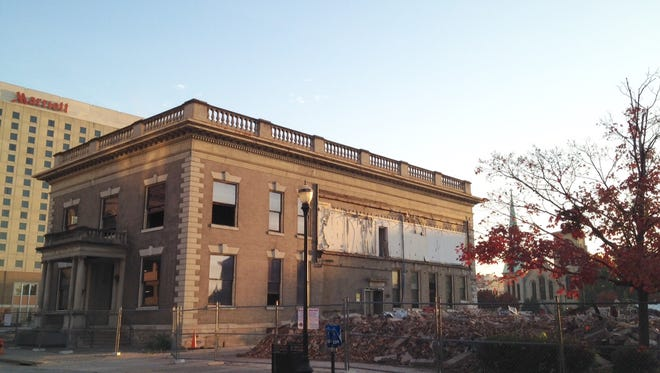 The 1910 Water Co. structure remains, but the 1914 structure next door has been demolished.