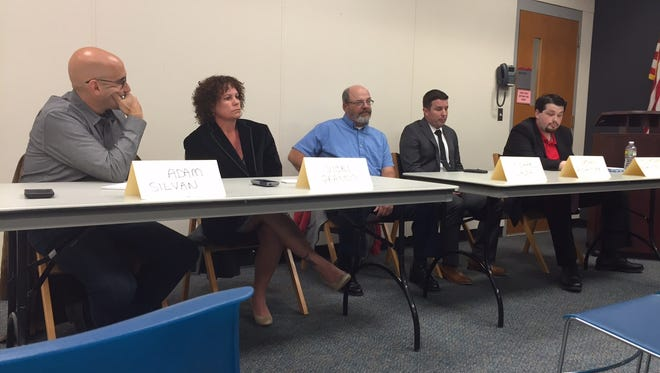 Jackson school board candidates (l-r) Adam Silvan, Vicki Grasso, Mike Walsh, Nathan Grosshandler and Jonathan Regan-Levine speak at a candidates' forum at the Jackson library.