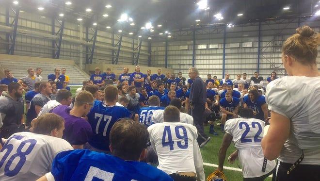 John Stiegelmeier addresses his team before a recent practice.