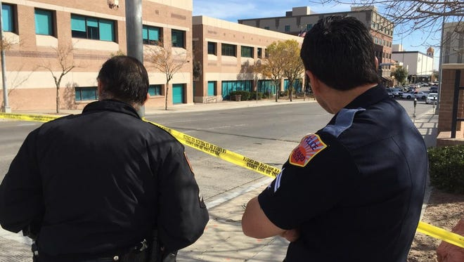El Paso police are shown investigating a suspicious package outside City Hall in Downtown. They blocked off a portion of Campbell Street.