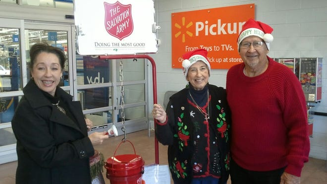 Volunteers Jim and Linda Clements and Kelly Foster ring the Salvation Army bell.