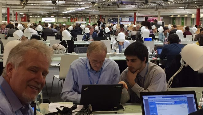York College professors Greg Foy and Keith Peterman with student Gilbert Vial in the media center at COP 21.
