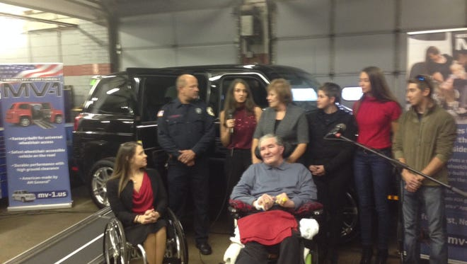 Hainesport firefighter Paul Hullings (left rear) stands next to Liz Woodward and some of her family members, who were given a new MV-1 wheelchair accessible vehicle for Woodward's father Steve (front, right). Liz Woodward is a waitress in Delran and paid the tab for Hullings and a fellow firefighter's meal. They paid it forward and helped her search for a van for her father go viral. Mobility Ventures heard the story and donated the van.
