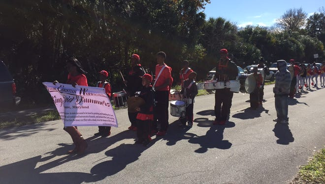 People march in a parade in Titusville to celebrate Martin Luther King Day.