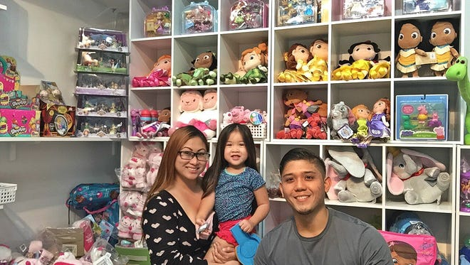 Giftforia owner Zana Flores, left, credits her store opening to her fiancé Ivan for his support and to her daughter Mila Rose who was the inspiration for it all.