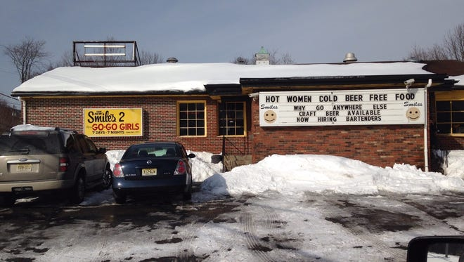 Authorities are investigating an armed robbery at the Smiles 2 go-go bar in Ledgewood.