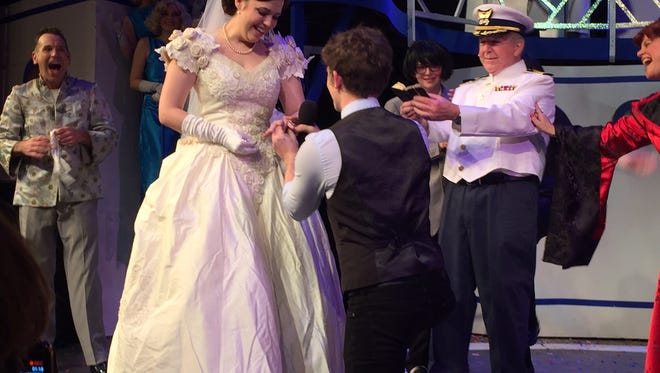 Actor Nicholas Sloan proposing to actress Jamie Leigh Walker at the Palm Canyon Theatre.