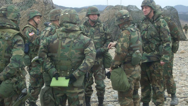 """Lt. Gen. Charles """"Hondo"""" Campbell, center, facing camera, with staff and soldiers under his command in South Korea, 2005. Campbell is from Shreveport."""