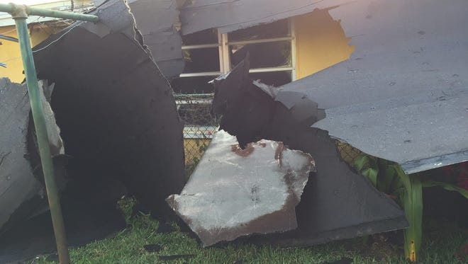 Roof damage in Cape Canaveral after storm hit Friday.