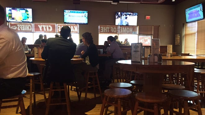 """Big TVs, high-top tables and booths make up the interior of The Other Place in Clive. There are nine other """"OPs"""" in the Iowa and Kansas."""