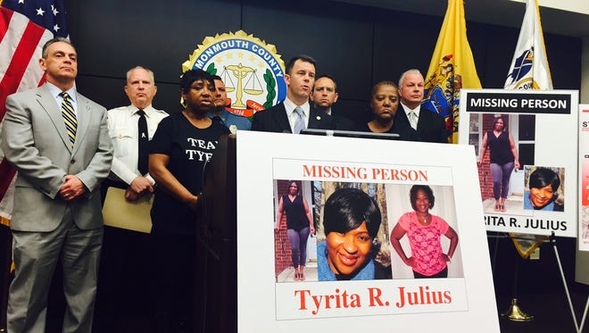 Acting Monmouth County Prosecutor Christopher J. Gramiccioni is accompanied by law enforcement officers and relatives of missing woman Tyrita R. Julius at a news conference asking the public for help in solving her disappearance.