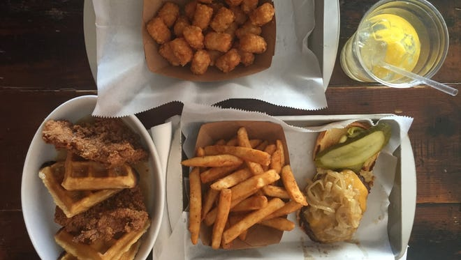 Chicken and waffles, tater tots, fresh lemonade and a classic burger at The Wooden Spoon in New Rochelle.