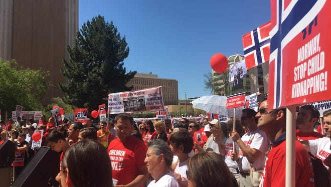 Hundreds protested the Norwegian child protective services on Saturday in downtown Phoenix.