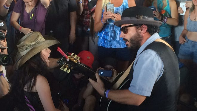 EmiSunshine, an 11-year-old country star, went out into the crowd to perform when the power went out on stage Sunday at Stagecoach.