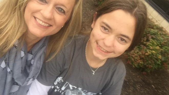 Montgomery Advertiser reporter Kym Klass with her daughter, Jenna, 12.