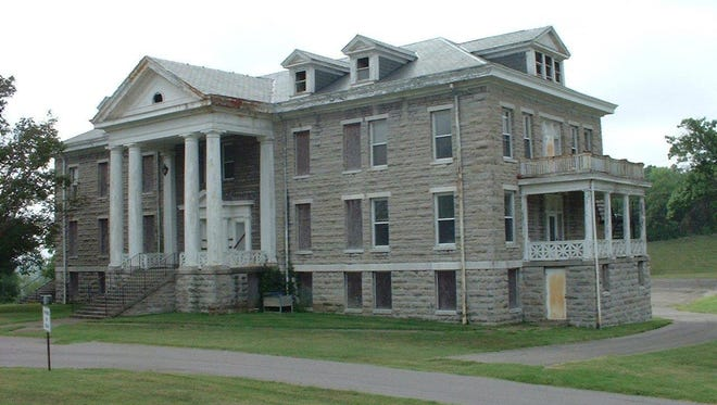 Local and state officials are attempting to save the three-story Home for Aged Masons, built in 1913, from demolition.