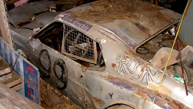 Leslie and Kenneth Langreck hope to find their missing Dick Trickle stock car shell so they can restore it.
