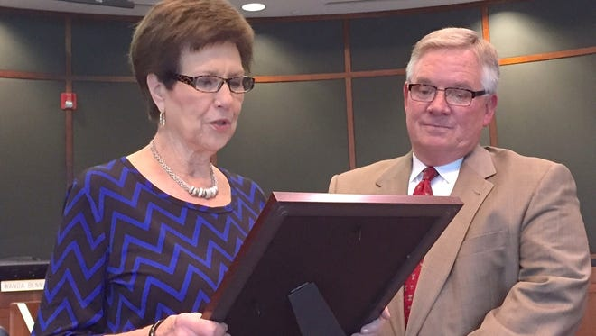 """Bossier Parish Police Jury President Wanda Bennett reads a resolution dedicated to retiring Superintendent of Schools D.C. Machen. """"It's easy to be an effective leader when you lead the best,"""" Machen said during remarks accepting the honor."""