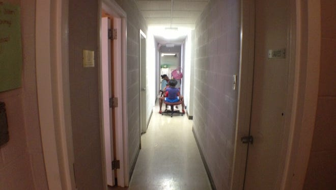 Children play  in the hallway of the Interfaith Hospitality Network day shelter in Walnut Hills.