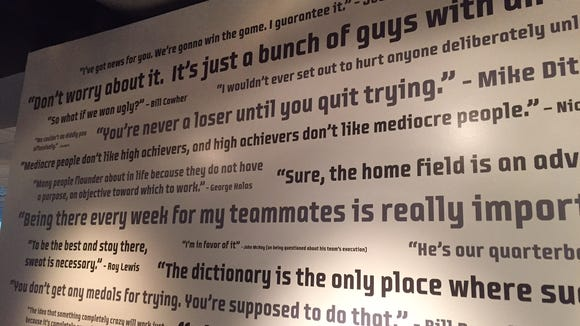 A wall with inspirational quotes from those prominent in the NFL is displayed at the EA Tiburon offices in Maitland.