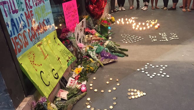Fans spelled out their love of Christina Grimmie with candles and posters.