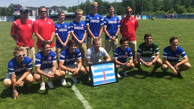 Major League Soccer goalie Steve Clark (center), a Mason native, was honored with the Mason boys soccer team during halftime of Lansing United's friendly against the Columbus Crew SC College Program.
