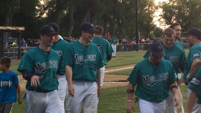 Dell Rapids Mudcats players celebrate after a Nate Henry home run Friday at Rickeman Field