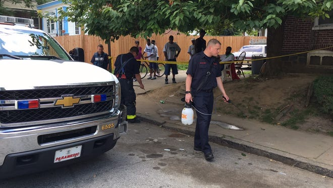 Authorities respond to a stabbing on West 26th Street in Wilmington on Thursday, June 30, 2016.