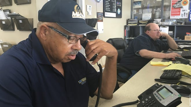 "Theodore ""Johnny"" Jones, 78, answers the phone at the Salisbury Delaware Tire Centers location on Tuesday, July 6. Jones has worked at the business for 57 years."